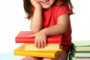 baby girl with books