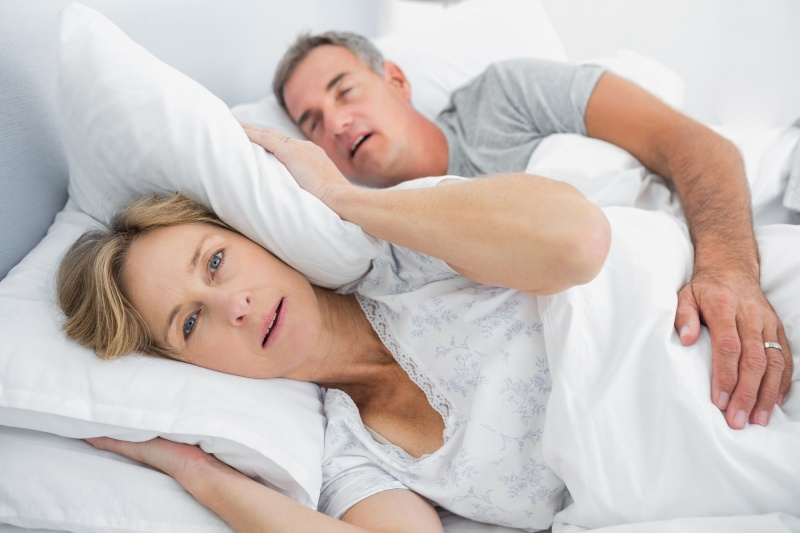 wife disturbed with husband snoring